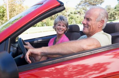 couple-in-convertible-car-smiling_hy8li5rro