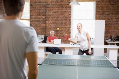 man-and-woman-in-office-space-playing-ping-pong_btw0iucss