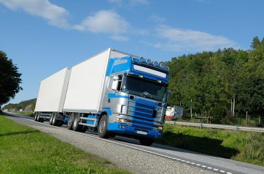 delivery-truck-driving-on-highway_htmlbwlrvj