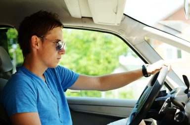 young-man-driving-a-car_ryheqc4j