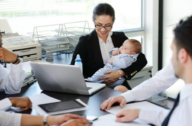 business-people-taking-care-of-baby-in-office_bt7kj04i