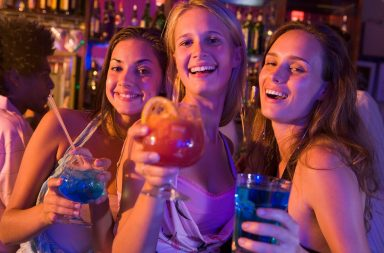 three-young-women-with-drinks-in-a-nightclub_sye_c2rro