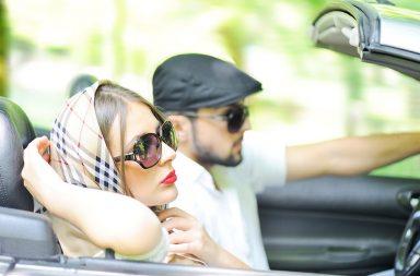 two-happy-and-sensual-caucasian-friends-having-drive-on-cabriolet-car_rfc-zgk6bi
