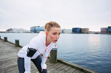 female-runner-standing-bent-over-and-catching-her-breath-after-a-running-session-along-river-young-woman-taking-break-after-a-run_saug8lnfg