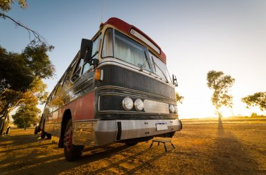 graphicstock-vintage-bus-on-a-hyden-farm-western-australiawith-sunrise-in-the-morning_su5jpipgil
