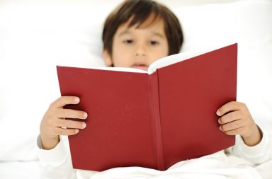 kid-reading-book-in-bed-focus-on-the-book_rfob3yrsi-2