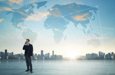 graphicstock-international-business-concept-with-businessman-on-city-skyline-background-with-network-on-map-and-sunlight_r_at7np
