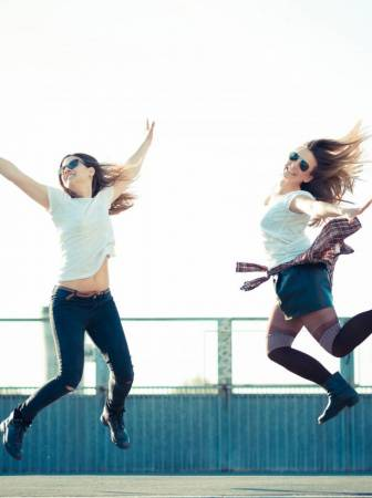 graphicstock-two-beautiful-young-women-jumping-and-dancing-in-the-city_hlg2wuvwez