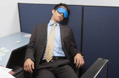 businessperson-sleeping-in-office_sfmxv-chi