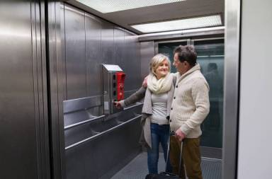 graphicstock-beautiful-senior-couple-with-luggage-standing-in-modern-elevator-people-travelling_suldpkfumb