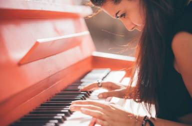 graphicstock-close-up-of-a-young-beautiful-reddish-brown-hair-caucasian-girl-playing-piano-creative-performance-music-concept-sh