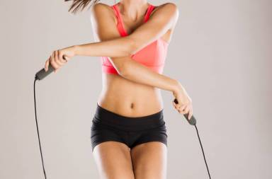 graphicstock-young-active-woman-with-rope-is-training-in-studio_h0lnmcei-z