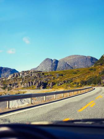 storyblocks-driving-a-car-on-mountain-road-norway_hug310wdjf
