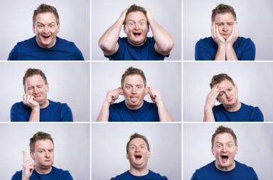 graphicstock-funny-young-adult-showing-his-emotions-expressively-by-his-gestures-and-mimics-studio-shot-on-white-background_sab18lazb