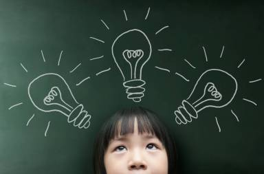 graphicstock-little-girl-with-light-bulb-on-the-blackboard-background_bomluk3pesx