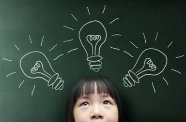graphicstock-little-girl-with-light-bulb-on-the-blackboard-background_bomluk3pesx