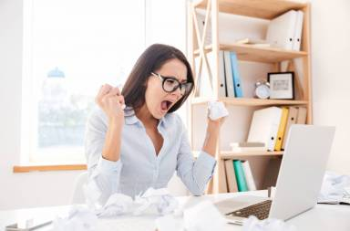 graphicstock-picture-of-angry-businesswoman-dressed-in-white-shirt-sitting-in-her-office-and-screaming-while-tear-paper-look-at-laptop_sucfkyxd3x