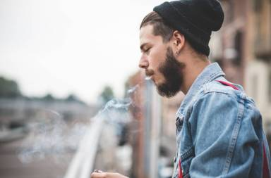 graphicstock-young-handsome-bearded-hipster-man-smoking-cigarette-in-the-city_ba4nvuok