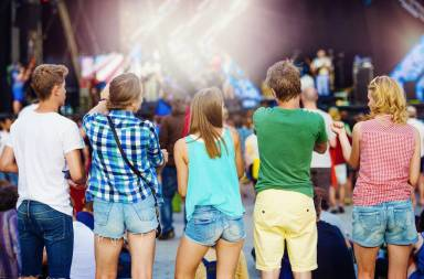 graphicstock-group-of-beautiful-teens-at-concert-at-summer-festival_rad-c66zz