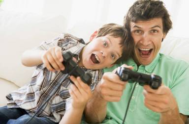 man-and-young-boy-with-video-game-controllers-smiling_ht1gpui0ss